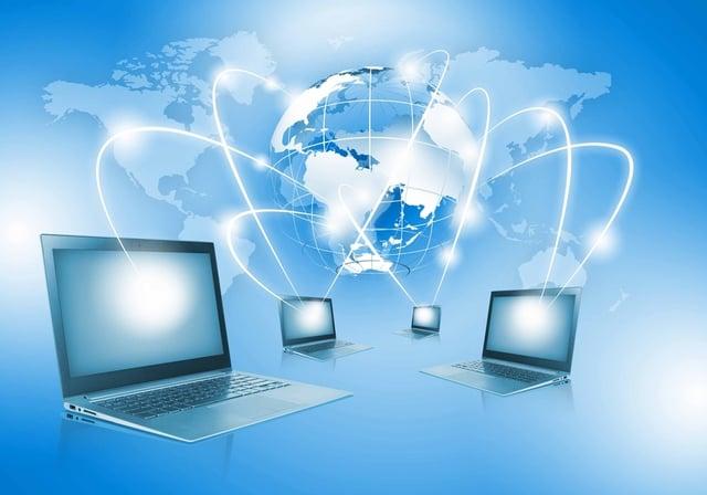 Image of laptop with globe illustration at background.jpeg